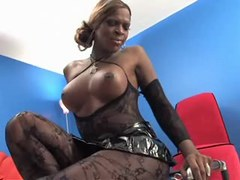Big black tranny in stockings poses